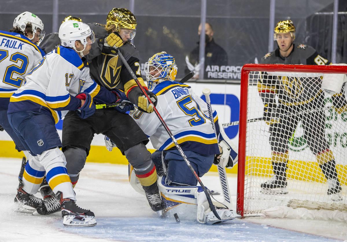 Golden Knights center William Karlsson (71) battles near the net for a scoring opportunity over ...