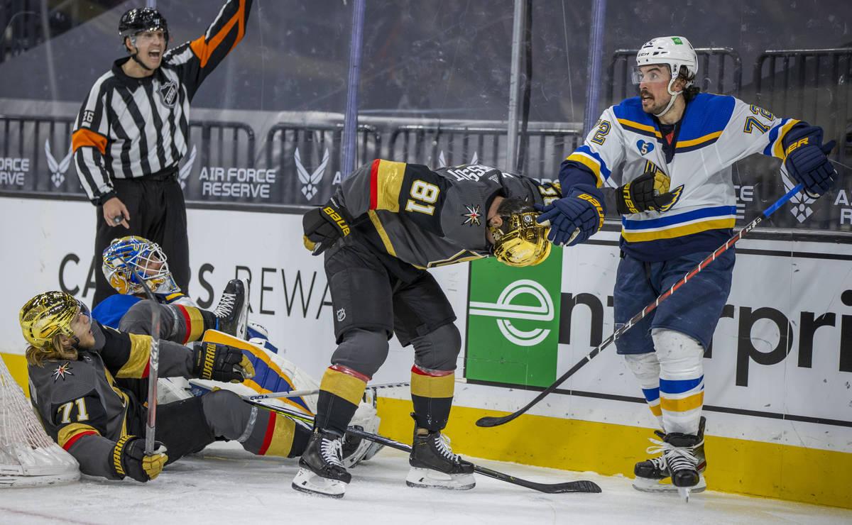 Golden Knights center William Karlsson (71) is taken down on the ice by St. Louis Blues goalten ...