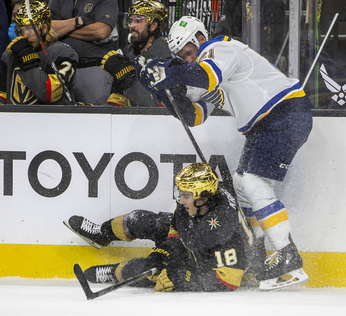 Golden Knights left wing Peyton Krebs (18) is taken down on the ice by St. Louis Blues center T ...