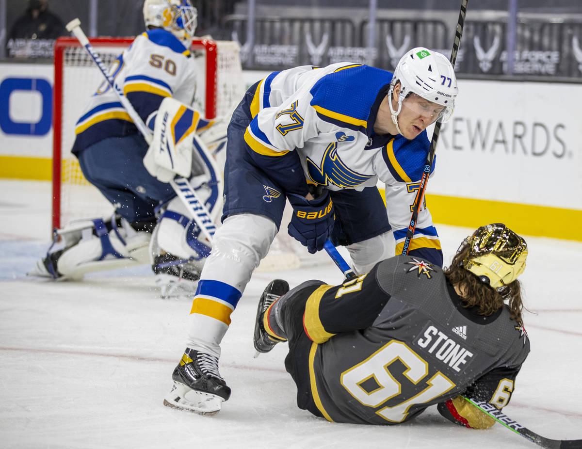 St. Louis Blues defenseman Niko Mikkola (77) knocks Golden Knights right wing Mark Stone (61) t ...