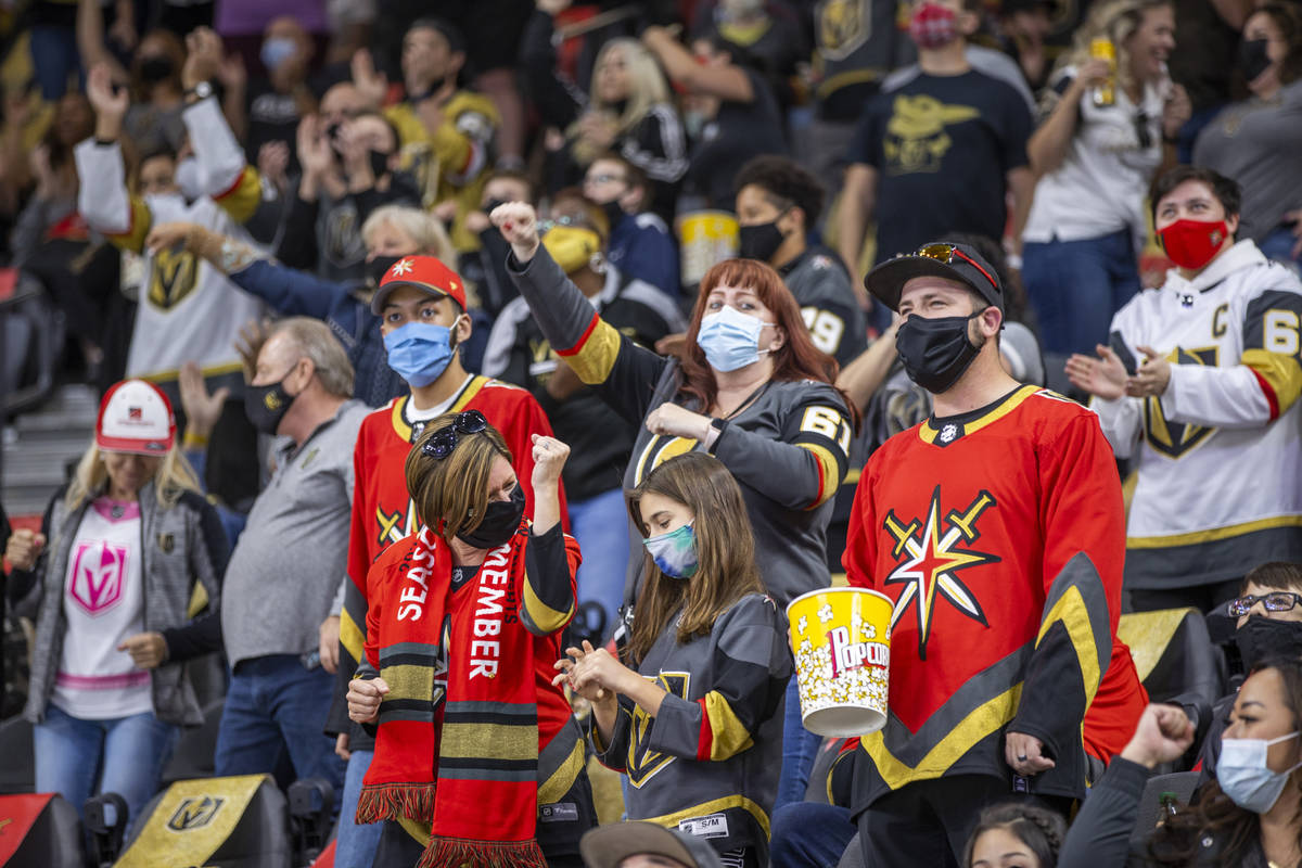 Golden Knights fans celebrate a goal by defenseman Alec Martinez (23) over the St. Louis Blues ...