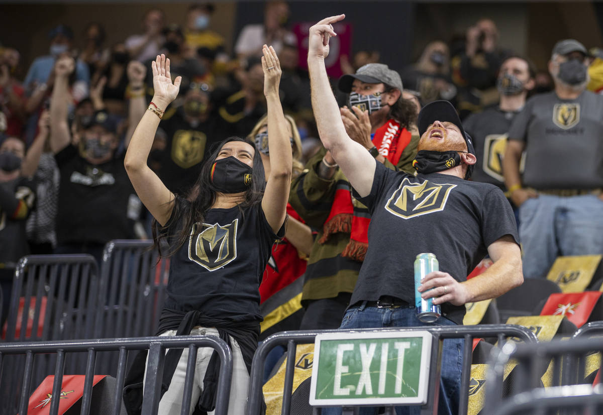 Golden Knights fans celebrate a goal during the third period of an NHL game versus the St. Loui ...