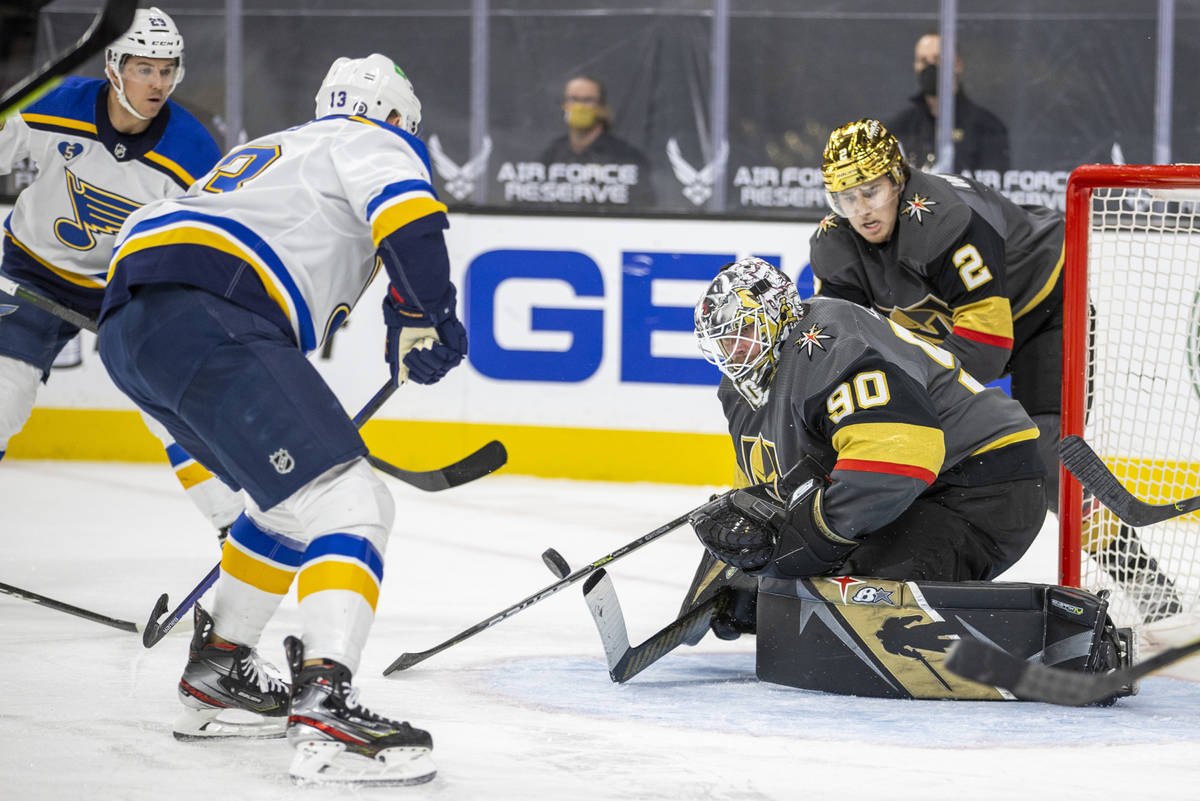 Golden Knights goaltender Robin Lehner (90) rejects a shot by St. Louis Blues left wing Kyle Cl ...