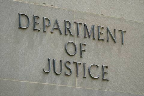 This May 4, 2021, photo shows a sign outside the Robert F. Kennedy Department of Justice buildi ...