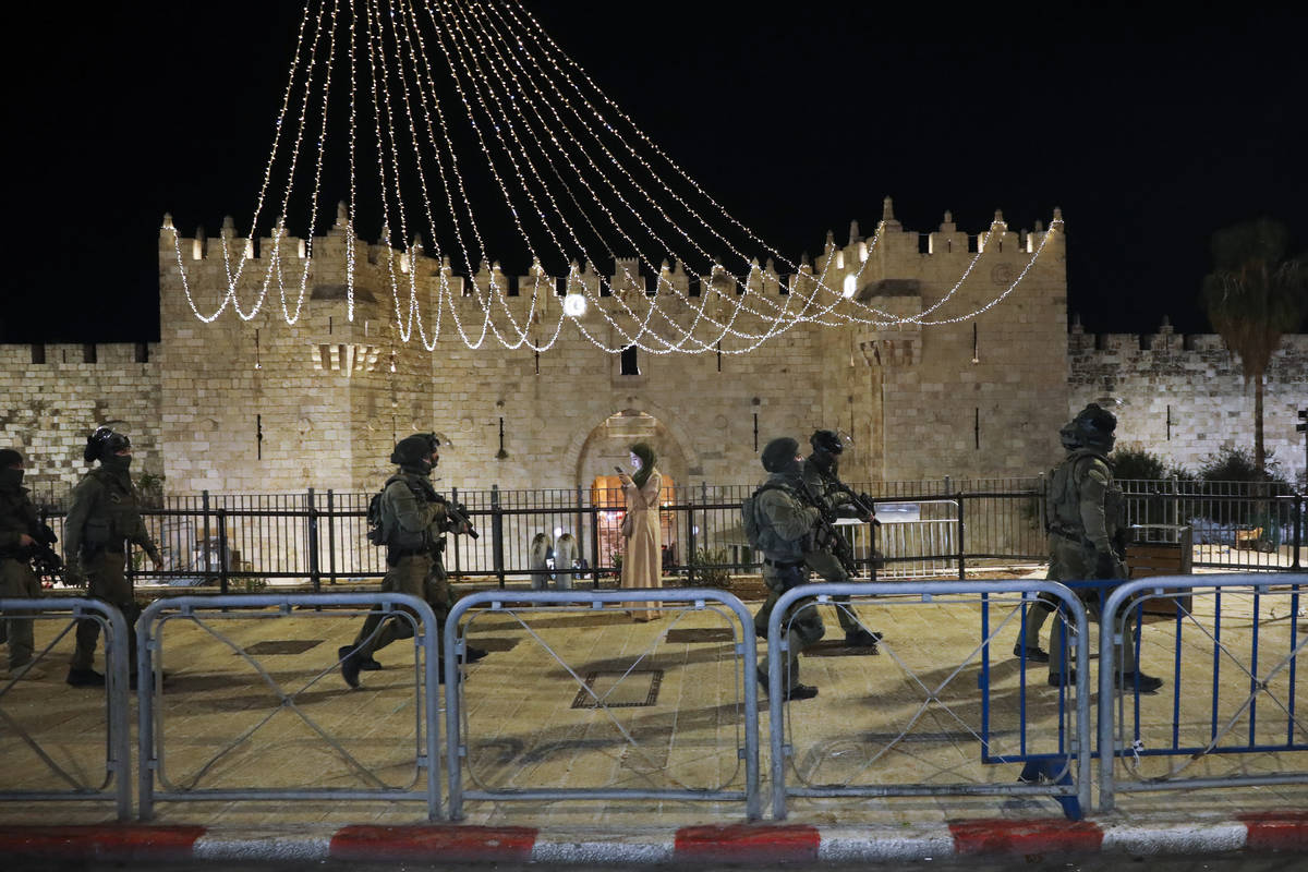 Israeli border police officers deploy during clashes with Palestinian protesters next to Damasc ...