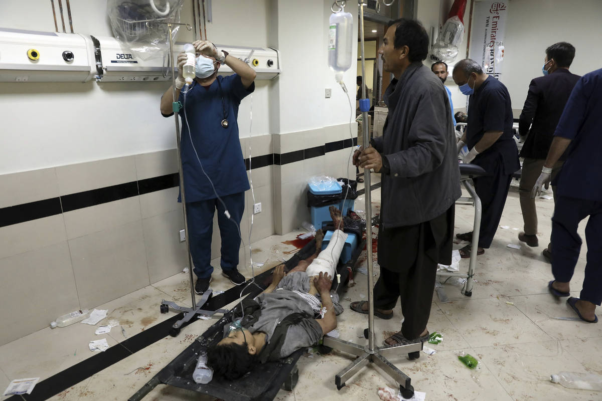 An Afghan school student treated at a hospital after a bomb explosion near a school west of Kab ...