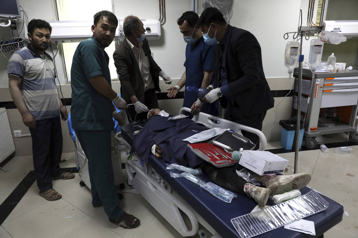 An Afghan school student is treated at a hospital after a bomb explosion near a school west of ...