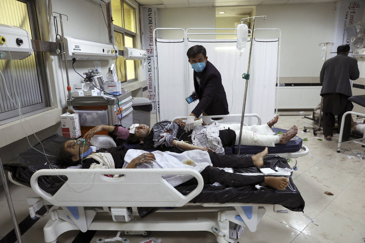 Afghan school students are treated at a hospital after a bomb explosion near a school in west o ...