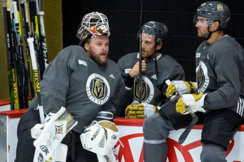 Vegas Golden Knights goaltender Robin Lehner (90, left) chats with defenseman Shea Theodore (27 ...