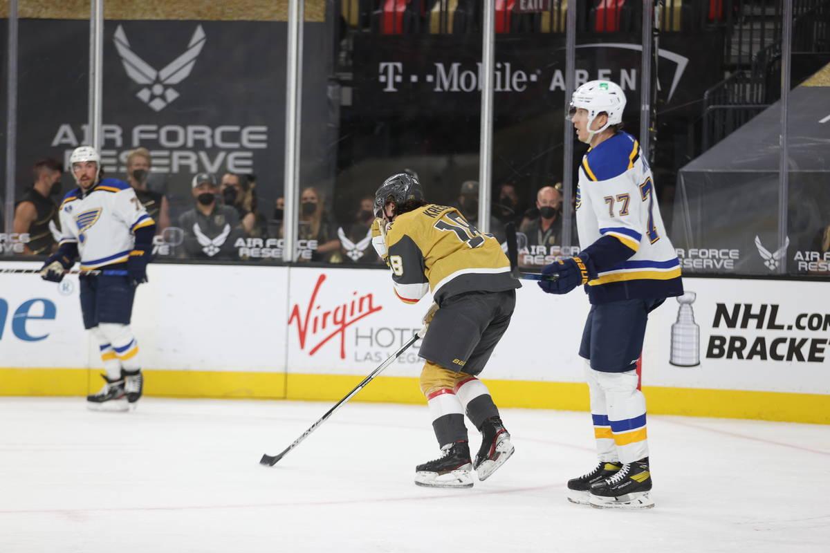 St. Louis Blues defenseman Niko Mikkola (77) looks on as Vegas Golden Knights left wing Peyton ...