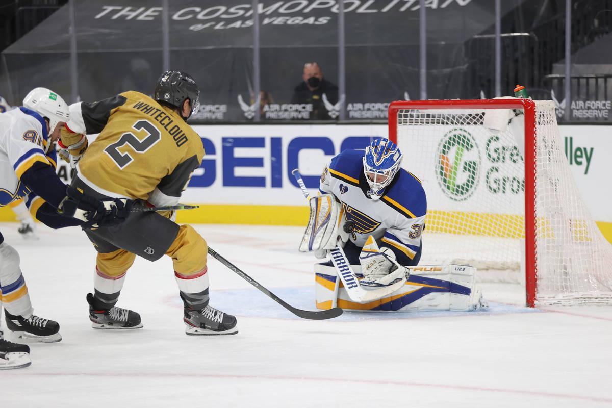 St. Louis Blues goaltender Ville Husso (35) defends a shot by Vegas Golden Knights defenseman Z ...