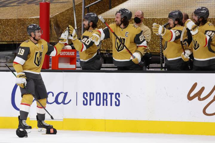 Vegas Golden Knights right wing Reilly Smith (19) high fives his team after his third goal agai ...