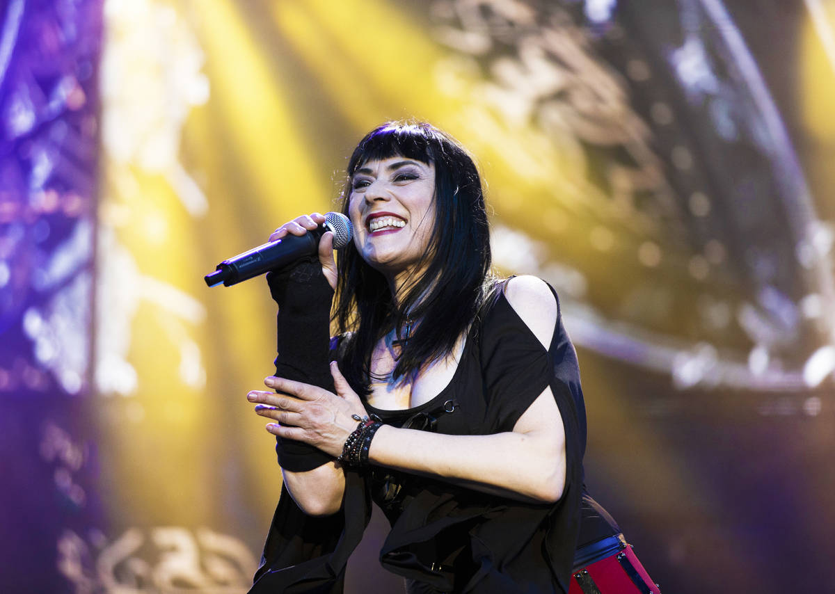 """Elyzabeth Diaga, lead singer in """"Queens of Rock,"""" performs at Mosaic on the Strip ..."""