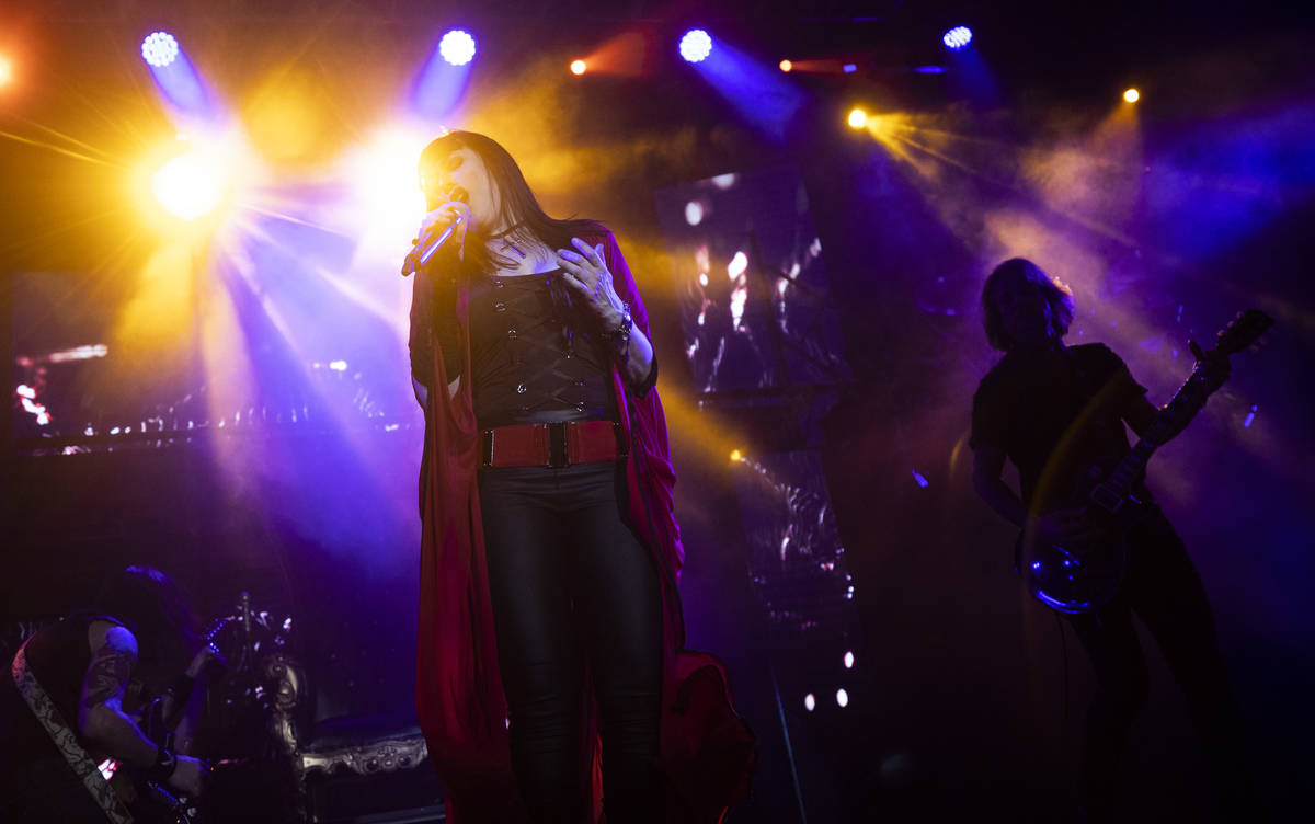 """Elyzabeth Diaga, lead singer in """"Queens of Rock,"""" performs at Mosaic on the Strip during a show ..."""