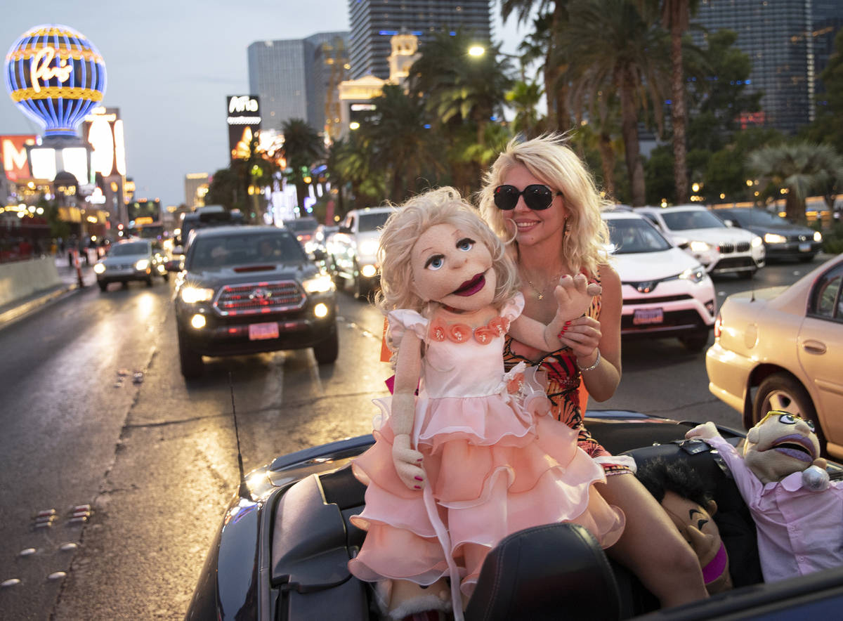 Actress and comedian April Brucker drives south in a motorcade of entertainment workers on the ...