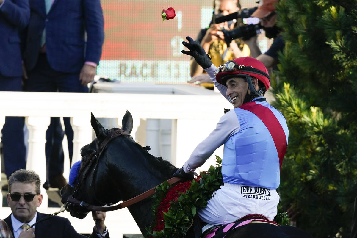 John Velazquez riding Medina Spirit throws a rose after his victory in the 147th running of the ...