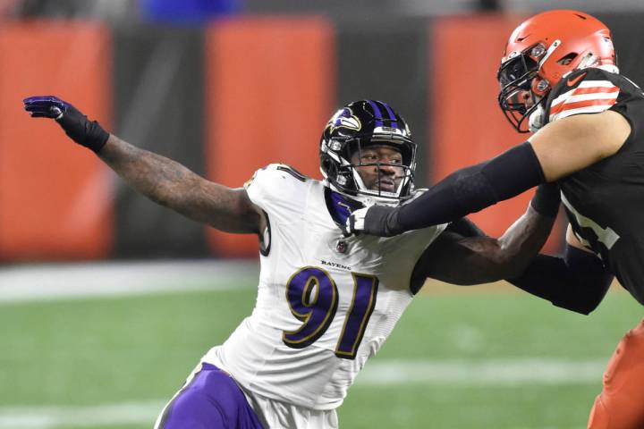 FILE - In this Dec. 14, 2020, file photo, Baltimore Ravens' Yannick Ngakoue (91) rushes the pas ...