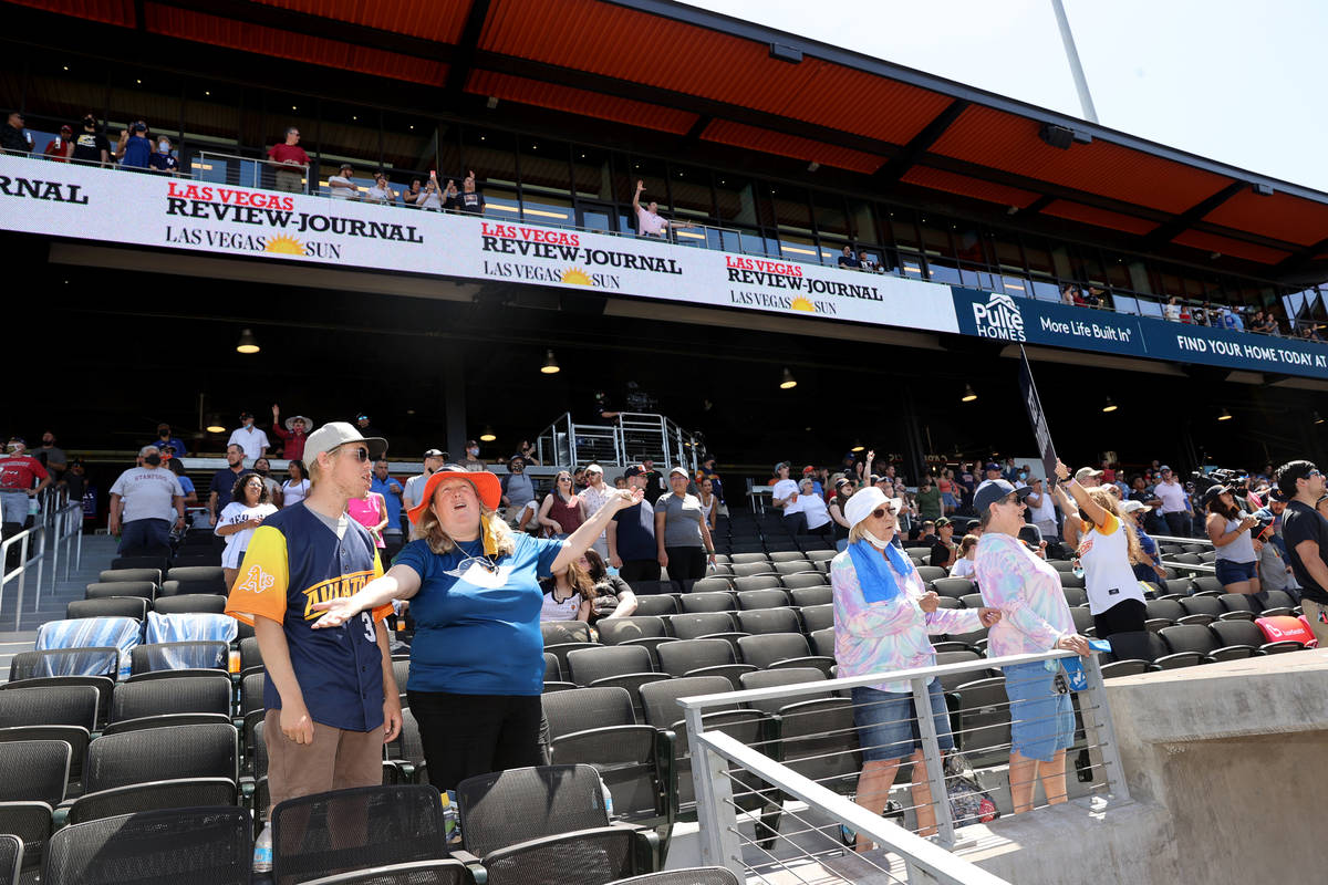 """Maria Engdahl and her son Mitchell, 17, sing """"Take Me Out to the Ballgame"""" during the ..."""