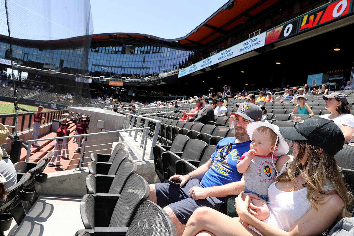 Kelsey Law watches the game with her son Chandler, 11 months, and husband Matt at Las Vegas Bal ...