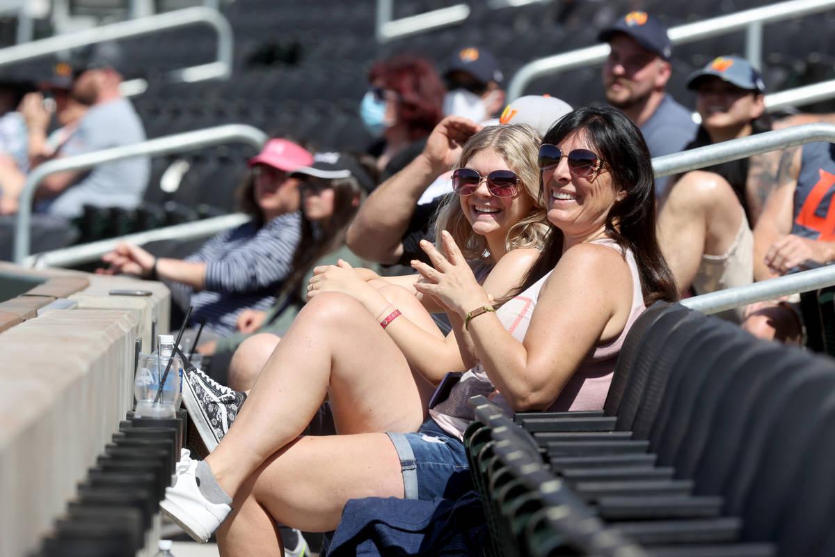 Laurel Grantham and her daughter Kaitlyn, 15, soak in the sun at Las Vegas Ballpark as the Las ...