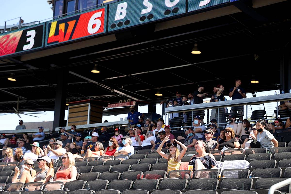 Kayla Cox and her daughter Kira, 10, watch the game at Las Vegas Ballpark as the Aviators take ...