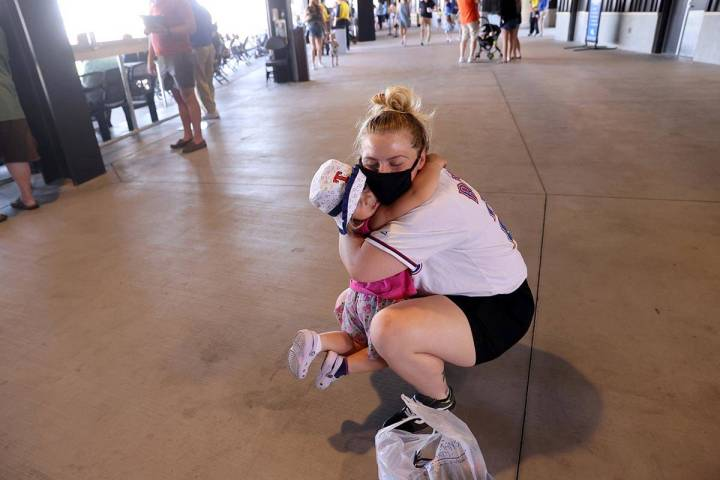 Rebecca Johnson gets a hug from her daughter Raylin, 2, on the concourse at Las Vegas Ballpark ...