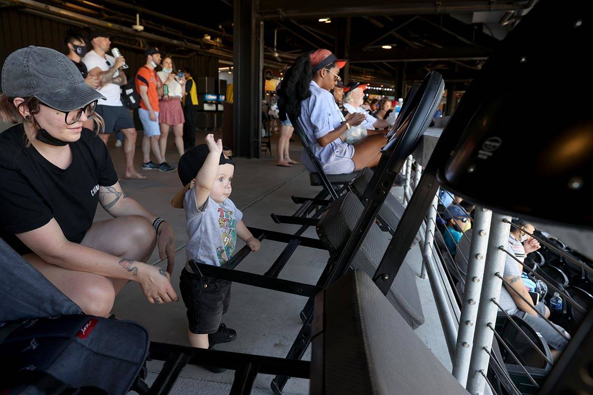 Mikayla Stevens and her son Maxtyn, 10 months, watch from the concourse at Las Vegas Ballpark b ...