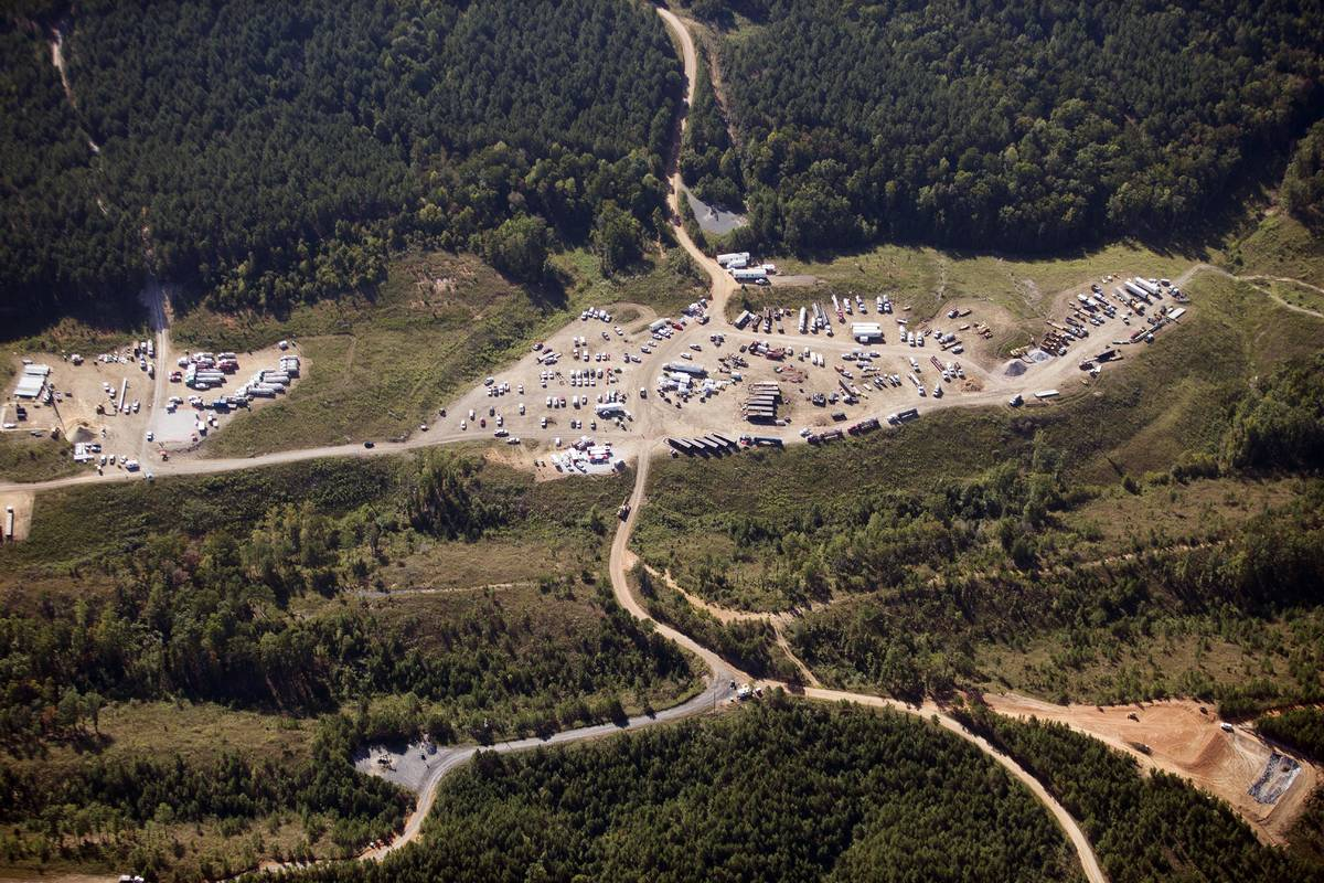 In this Sept. 20, 2016 file photo vehicles are seen near Colonial Pipeline in Helena, Ala. A m ...