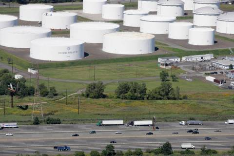 In this Sept. 8, 2008 file photo traffic on I-95 passes oil storage tanks owned by the Colonial ...