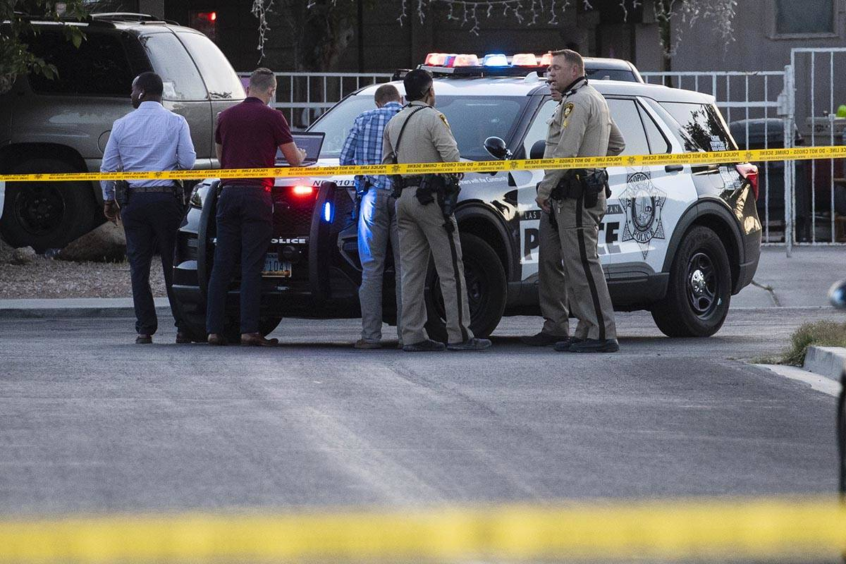 Metropolitan Police Department officers investigate a homicide at the 3200 block of Lava Avenue ...