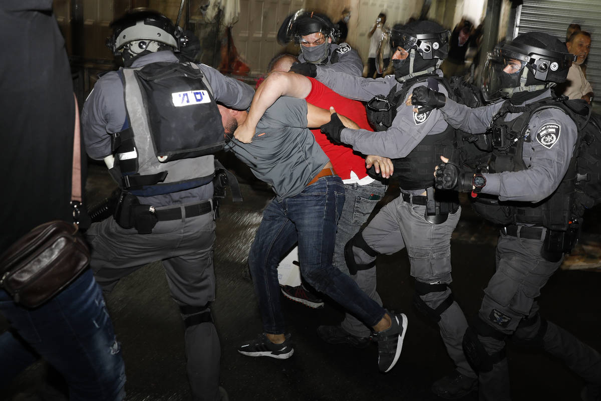 Israeli police officers clash with Palestinian protesters near Damascus Gate just outside Jerus ...