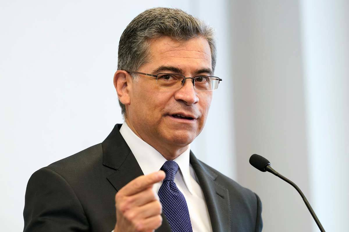 In this May 5, 2021 photo, Health and Human Services Secretary Xavier Becerra speaks at a healt ...