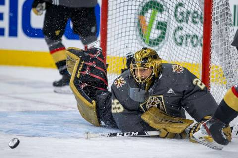 Golden Knights goaltender Marc-Andre Fleury (29) laughs while rejecting teammates shots during ...