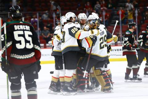 The Golden Knights celebrate with goaltender Marc-Andre Fleury (29) after an overtime win again ...