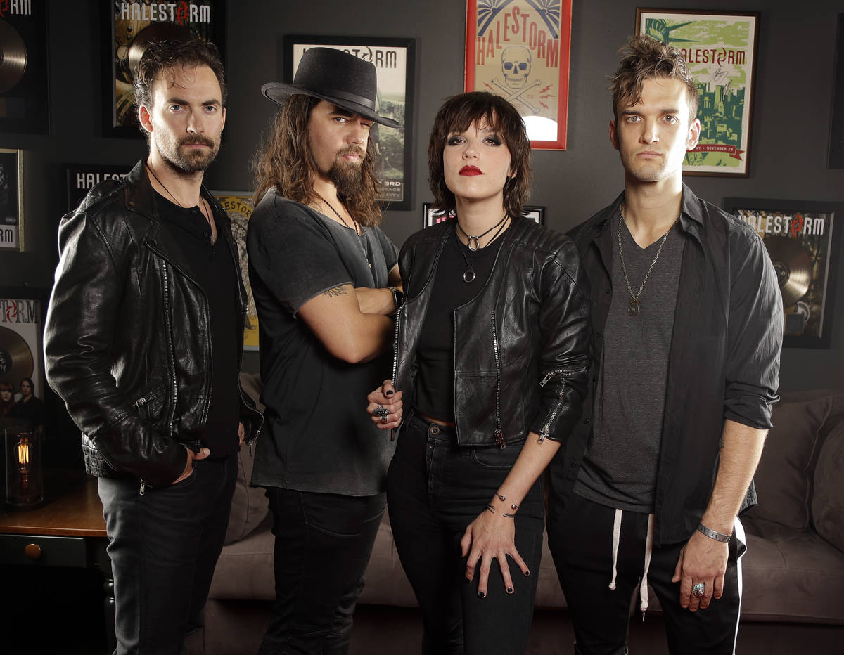 In this July 20, 2018, photo, members of Halestorm, from left, Josh Smith, Joe Hottinger, Lzzy ...