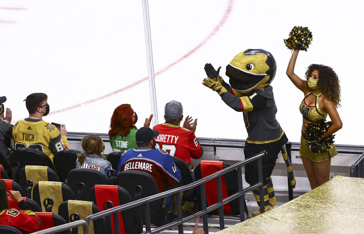 Golden Knights mascot Chance cheers with the crowd during the first period of an NHL hockey gam ...