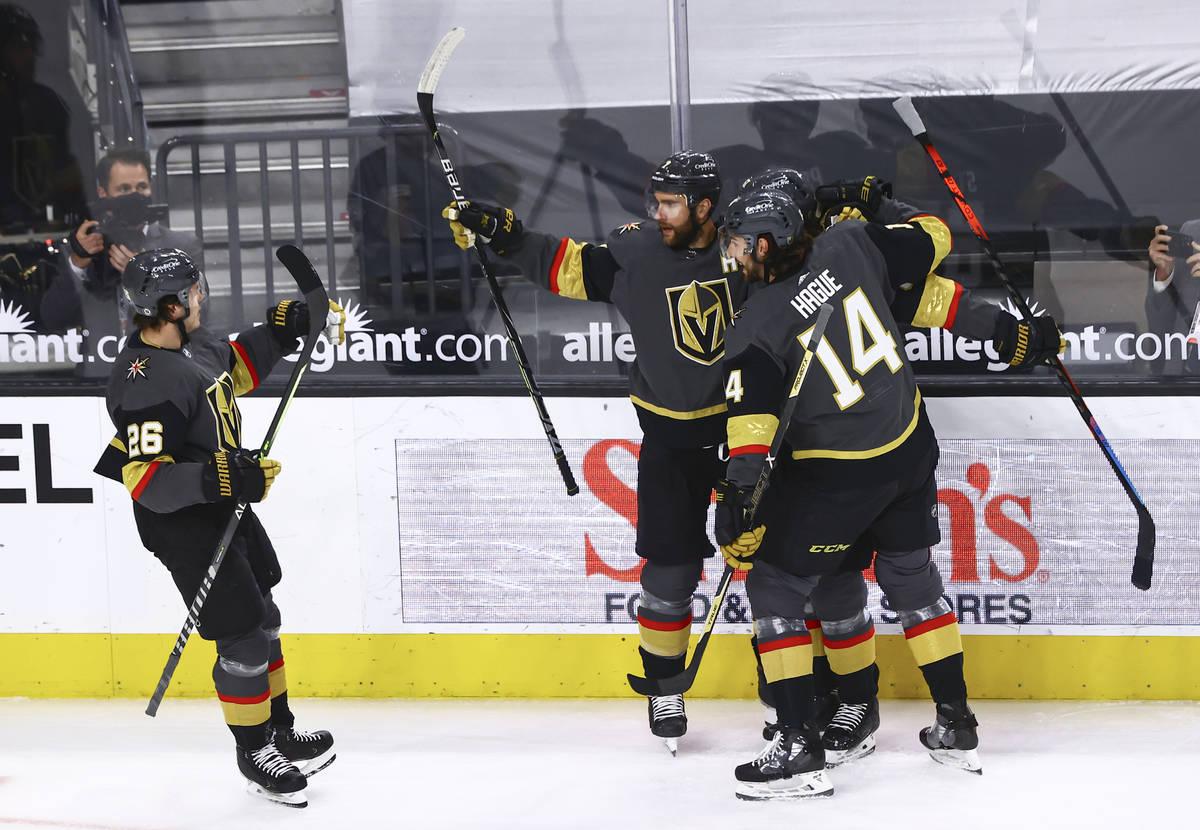 Golden Knights' Alex Pietrangelo, center, celebrates after his goal against Colorado Avalanche ...