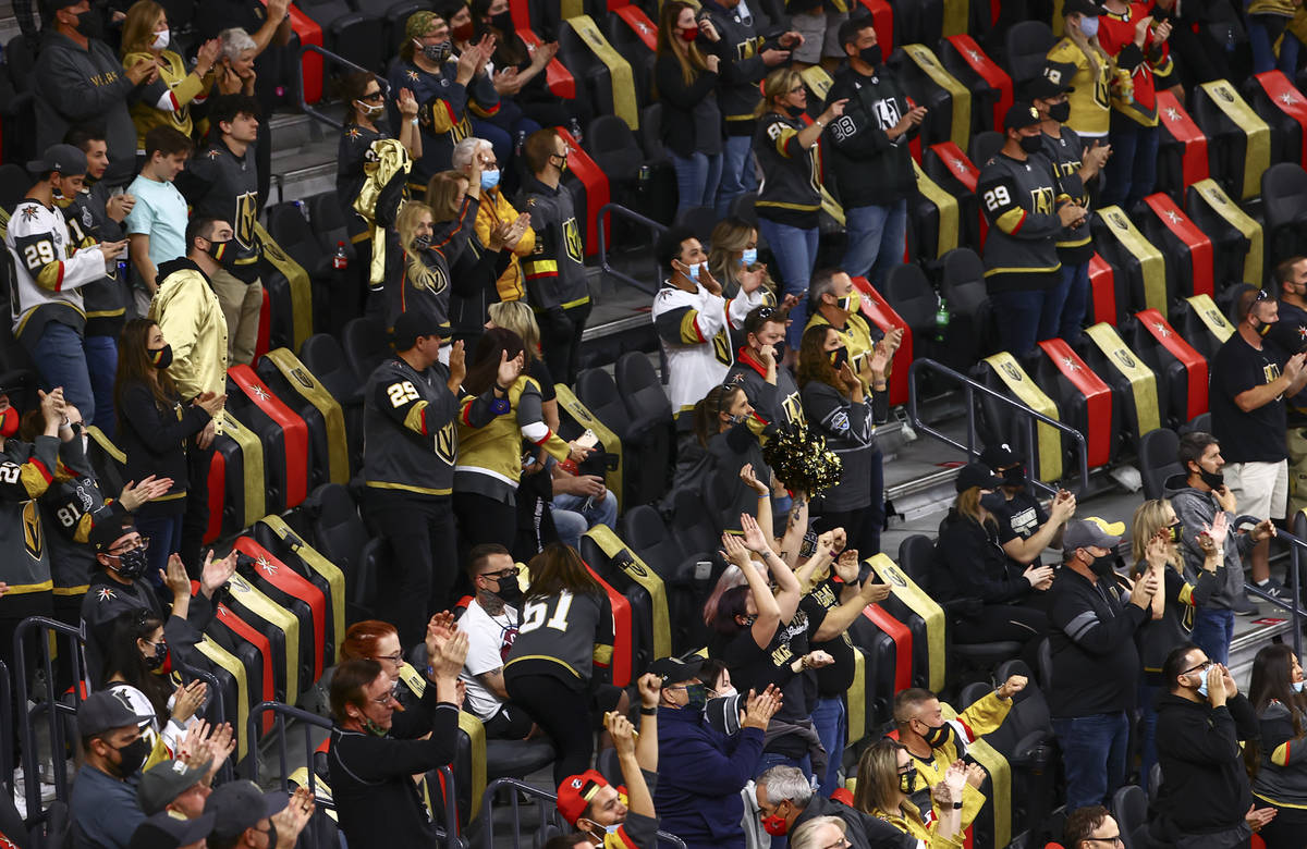 Golden Knights fans celebrate after a goal by defenseman Alex Pietrangelo, not pictured, durin ...