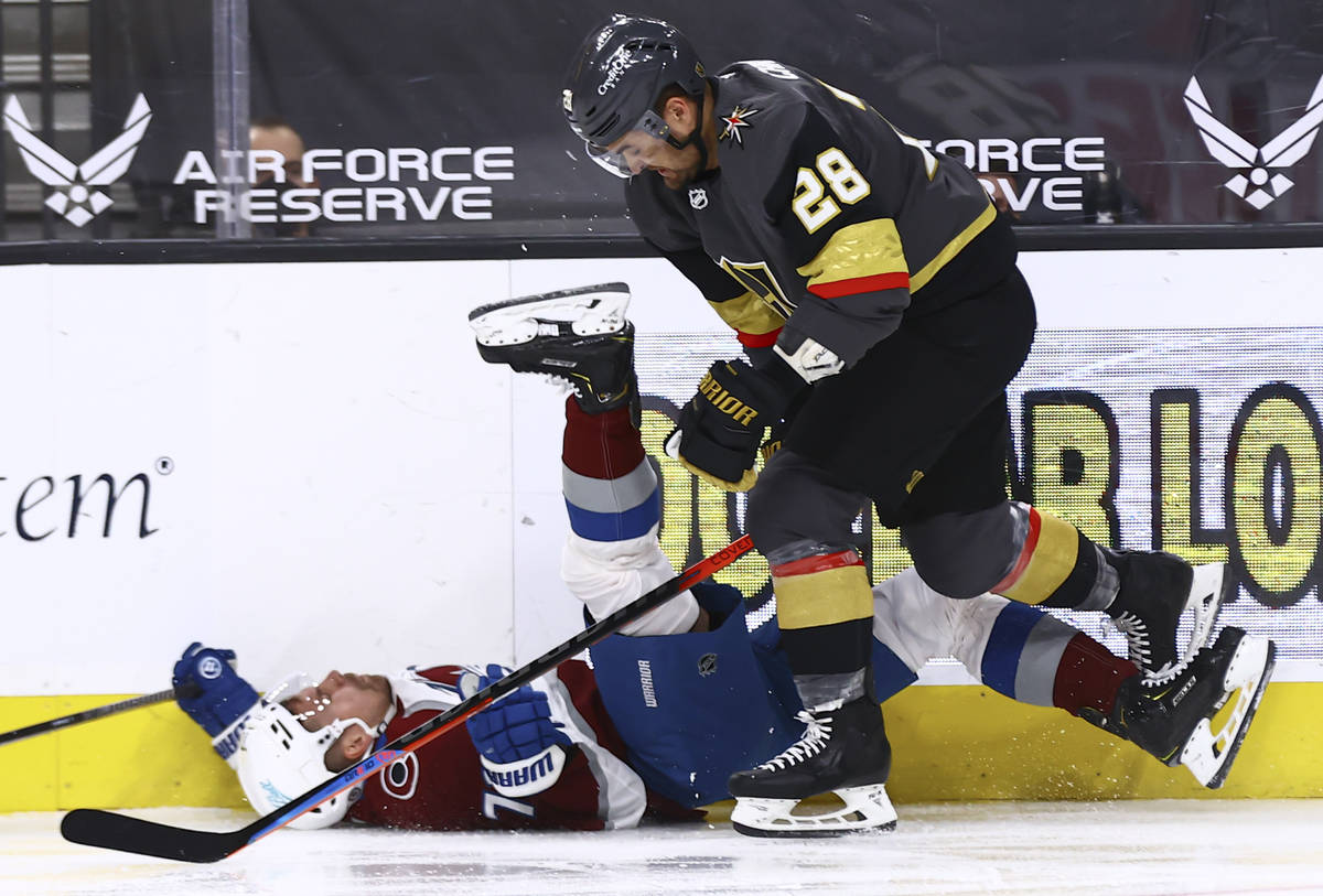 Colorado Avalanche's Joonas Donskoi (72) gets taken down to the ice by Golden Knights' William ...