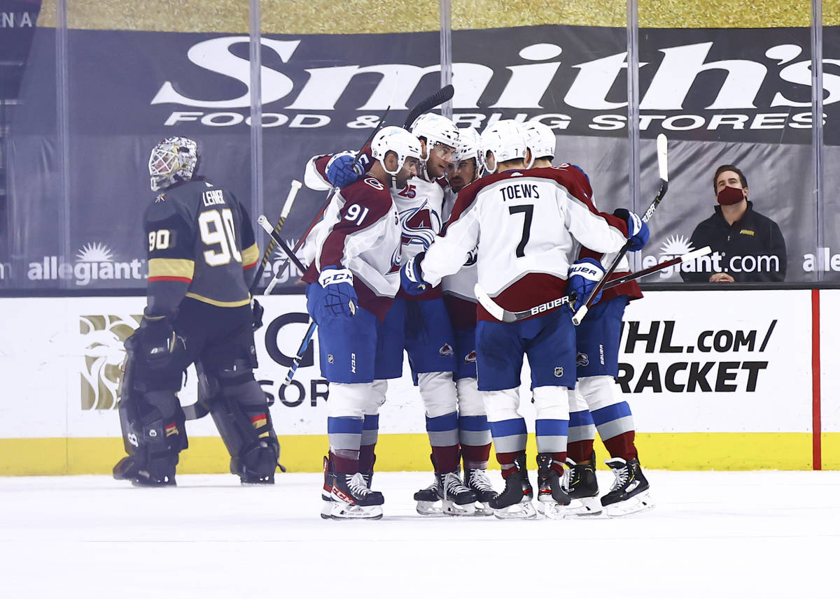 Colorado Avalanche players celebrate after a goal against the Golden Knights during the second ...