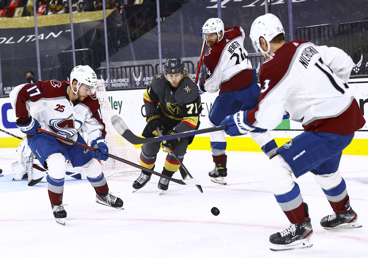 Golden Knights' William Karlsson (71) chases after the puck between Colorado Avalanche's Tyson ...