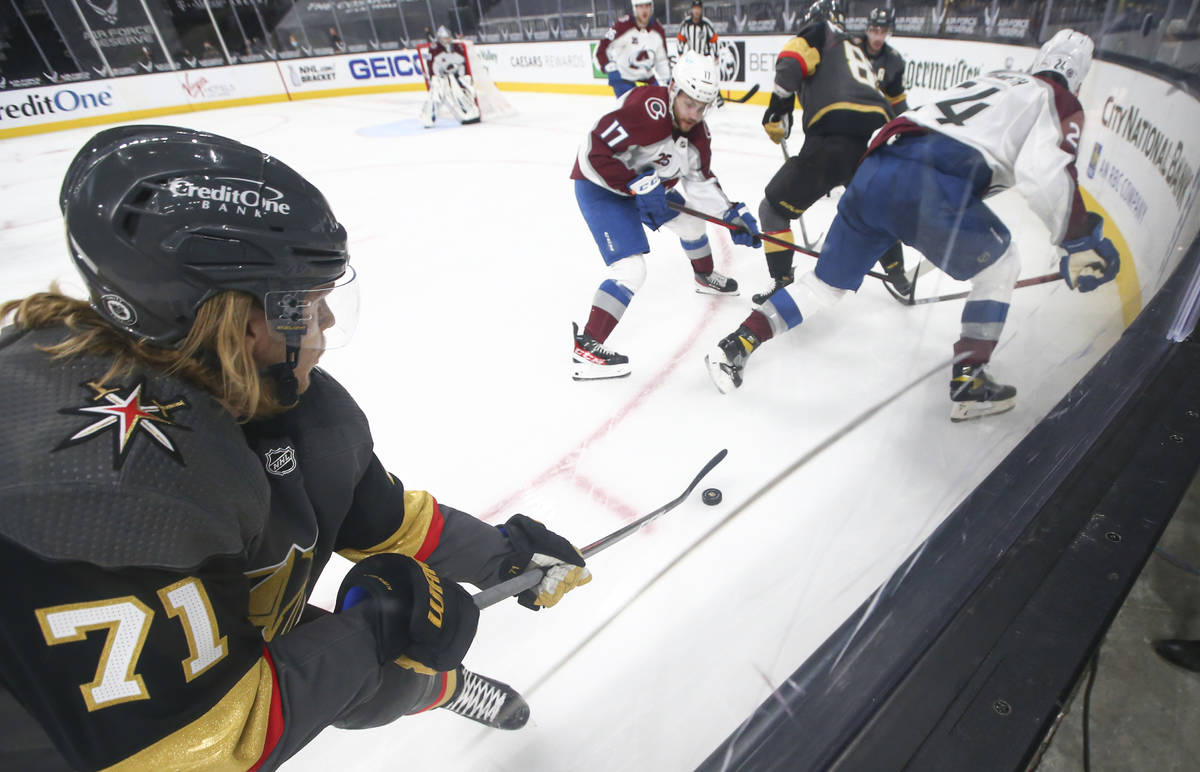 Golden Knights' center William Karlsson (71) controls the puck under pressure from the Colorado ...