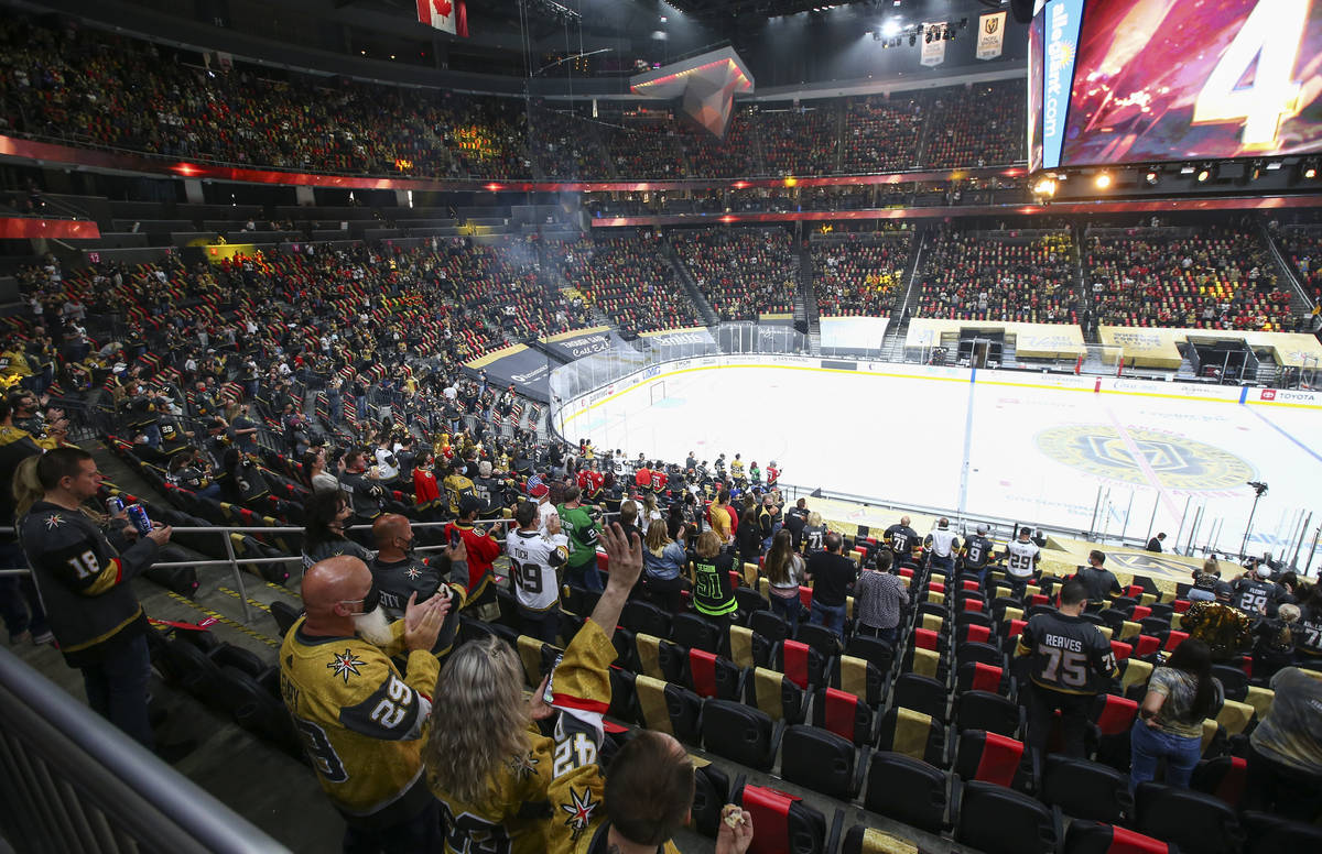 Golden Knights fans cheer before the start of an NHL hockey game against Colorado Avalanche at ...