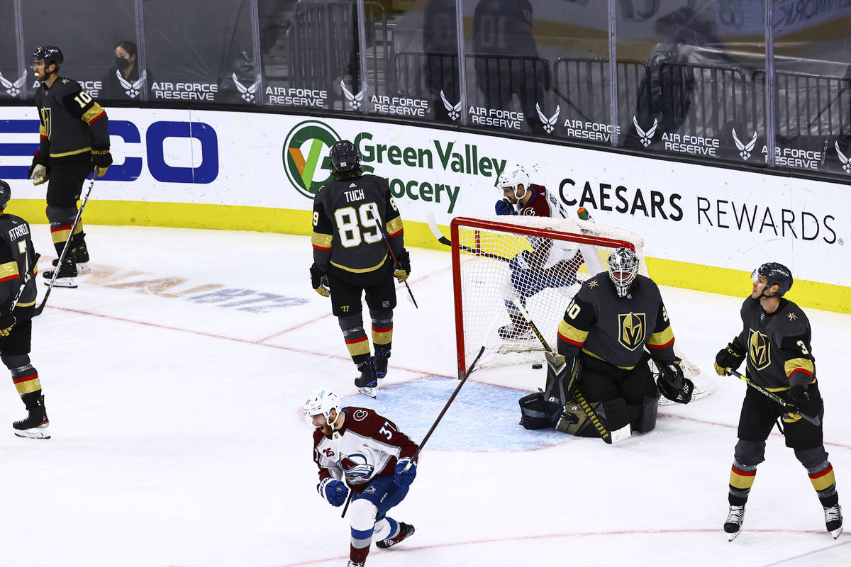 Colorado Avalanche's J.T. Compher (37) celebrates after scoring a goal past Golden Knights goal ...