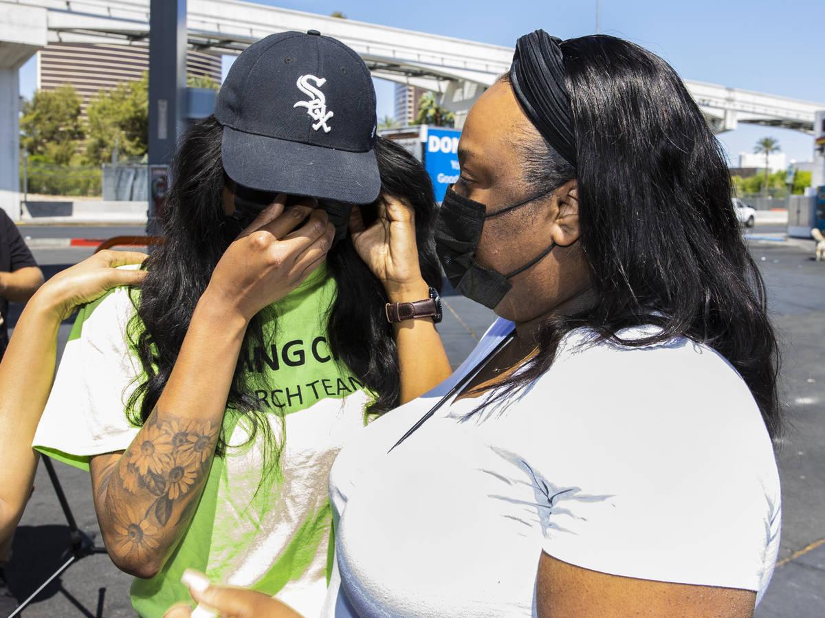Yolanda Everett, left, comforted by her sister D'Errica Perryman, both Amari Nicholson's, a chi ...