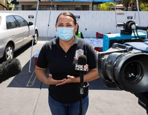 Margarita Edwards, executive director Nevada Child Seekers, addresses the media outside of Emer ...