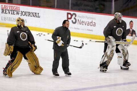 Golden Knights goaltenders Marc-Andre Fleury (29), left, and Robin Lehner (90) with coach Mike ...