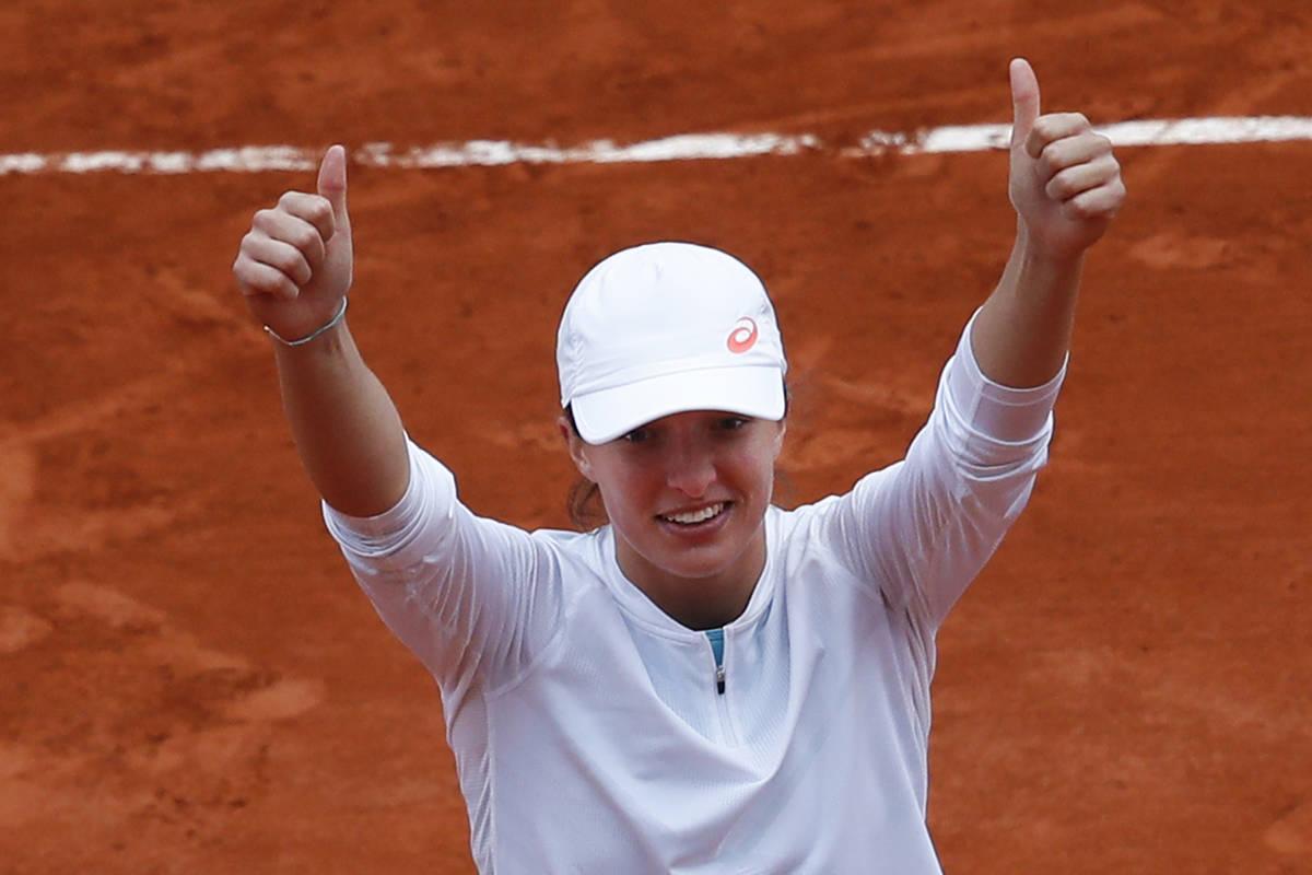 Poland's Iga Swiatek celebrates winning the final match of the French Open tennis tournament ag ...