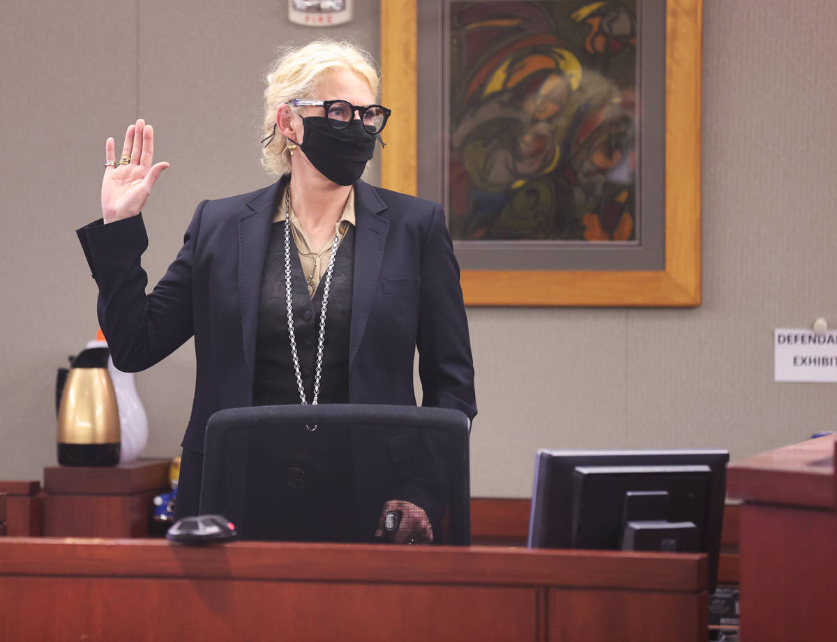 Michelle Dell, owner of Hogs & Heifers, is sworn in before testifying during a civil trial ...