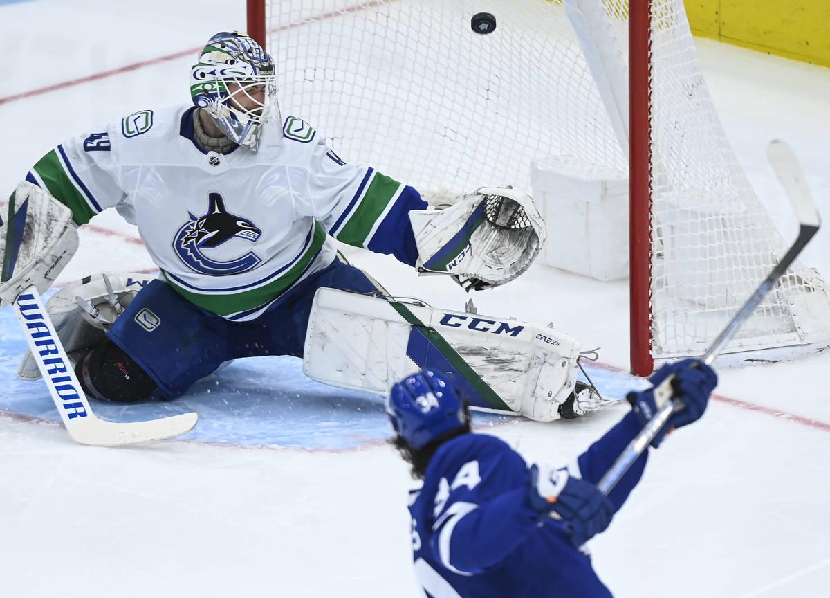 Toronto Maple Leafs forward Auston Matthews (34) scores past Vancouver Canucks goaltender Brade ...